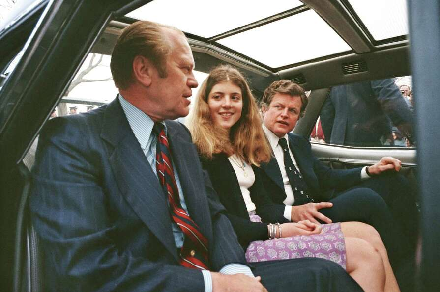 President Gerald Ford talks to Caroline Kennedy and Sen. Edward Kennedy, daughter and brother of the