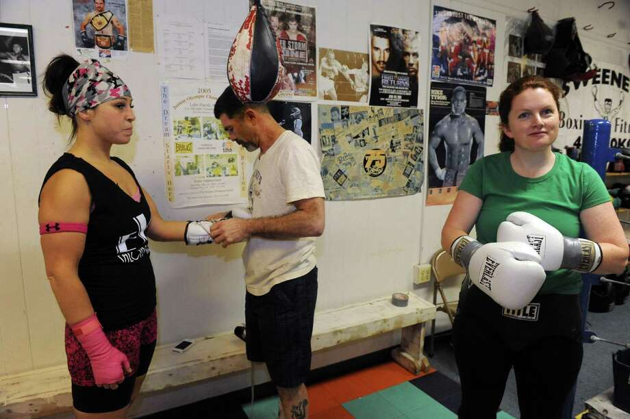 "Times Union feature writer Leigh Hornbeck, right, prepares to spar with professional boxer Sarah "" The Knockout"" Kuhn at Sweeney's Boxing on Wednesday March 6, 2013 in Delmar, N.Y. (Michael P. Farrell/Times Union) Photo: Michael P. Farrell"