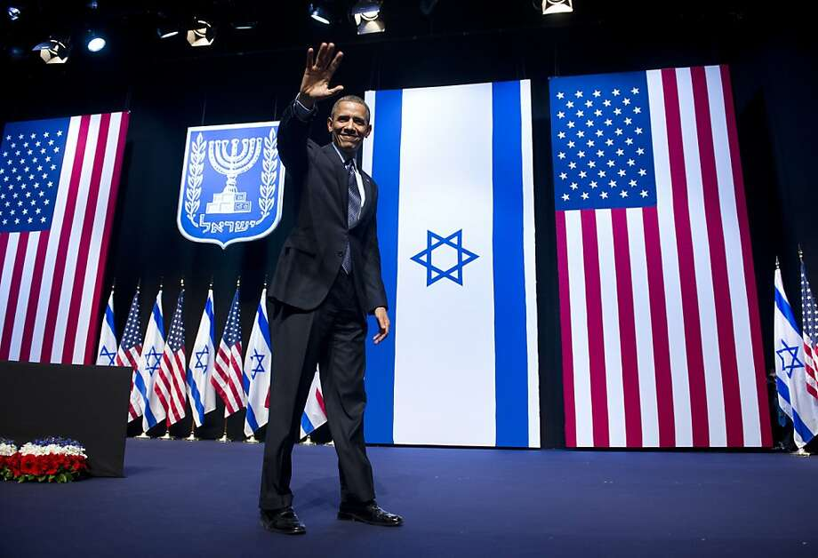 President Obama, speaking in Jerusalem, urges both Israelis and Palestinians to resume negotiations. The president, on a three-day trip to the region, received Israel's highest civilian honor. Photo: Saul Loeb, AFP/Getty Images