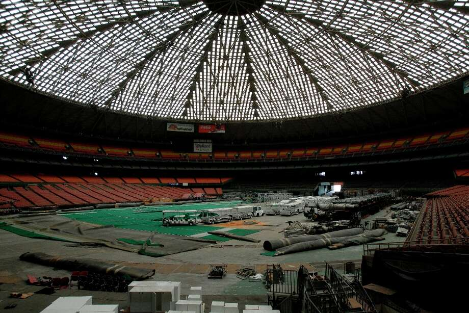 Trams are parked among pieces of AstroTurf across the stadium floor shown during a media tour of the Reliant Astrodome Thursday, March 21, 2013, in Houston. Photo: Melissa Phillip, Houston Chronicle / © 2013  Houston Chronicle