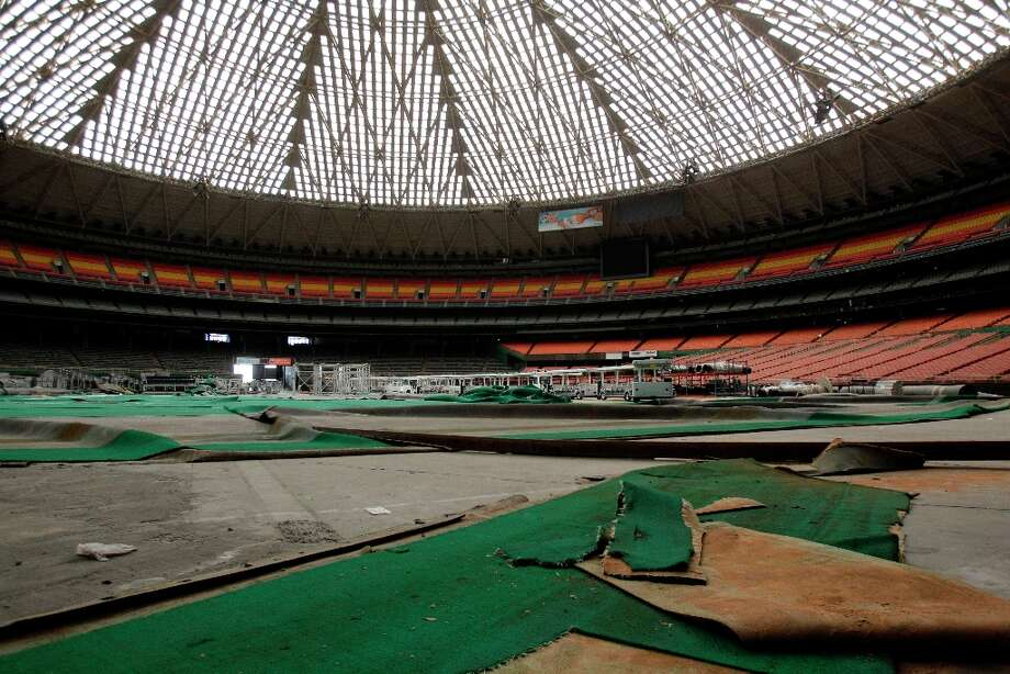 Pieces of AstroTurf lay across the stadium floor shown during a media tour of the Reliant Astrodome Thursday, March 21, 2013, in Houston. Photo: Melissa Phillip, Houston Chronicle / © 2013  Houston Chronicle