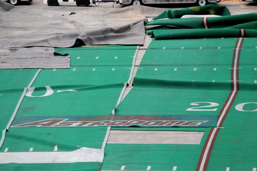 Pieces of AstroTurf lay across the stadium floor shown during a media tour of the Reliant Astrodome