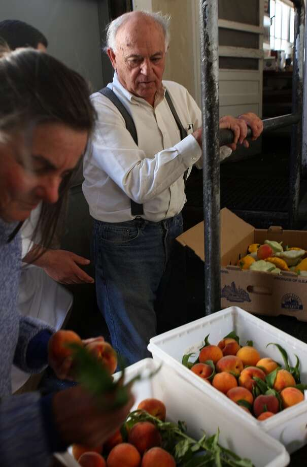 Jeanette and Ed Ueber, parents of chef JP Ueber, delivering a crop of Anderson peaches to Greens