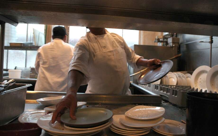 Dishes to be washed during a busy night at Greens