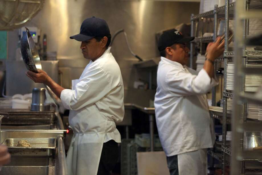 Mario Tavares (left) and Jorge Garcia (right) drying pans and dishes at Greens