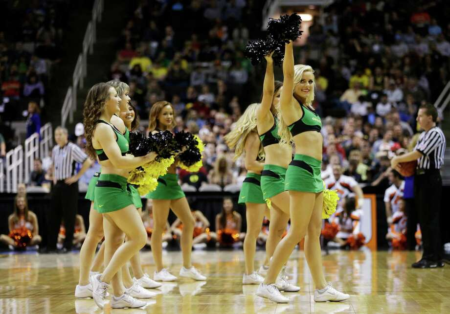 SAN JOSE, CA - MARCH 21:  The Oregon Ducks cheerleaders perform in the first half against the Oklahoma State Cowboys during the second round of the 2013 NCAA Men's Basketball Tournament at HP Pavilion on March 21, 2013 in San Jose, California. Photo: Ezra Shaw, Getty Images / 2013 Getty Images