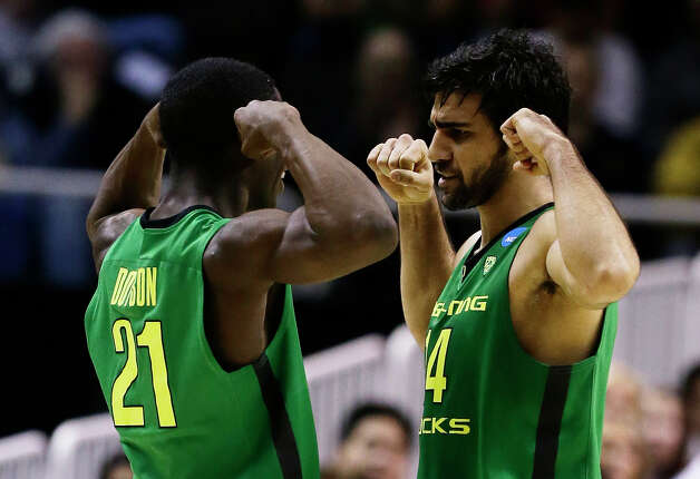 Oregon 68, Oklahoma State 55SAN JOSE, CA - MARCH 21:  Arsalan Kazemi #14 and Damyean Dotson #21 of the Oregon Ducks react in the first half against the Oklahoma State Cowboys during the second round of the 2013 NCAA Men's Basketball Tournament at HP Pavilion on March 21, 2013 in San Jose, California. Photo: Ezra Shaw, Getty Images / 2013 Getty Images