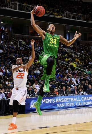 SAN JOSE, CA - MARCH 21:  Carlos Emory #33 of the Oregon Ducks goes up in front of Markel Brown #22 of the Oklahoma State Cowboys in the first half during the second round of the 2013 NCAA Men's Basketball Tournament at HP Pavilion on March 21, 2013 in San Jose, California. Photo: Thearon W. Henderson, Getty Images / 2013 Getty Images