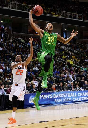 SAN JOSE, CA - MARCH 21:  Carlos Emory #33 of the Oregon Ducks goes up in front of Markel Brown #22