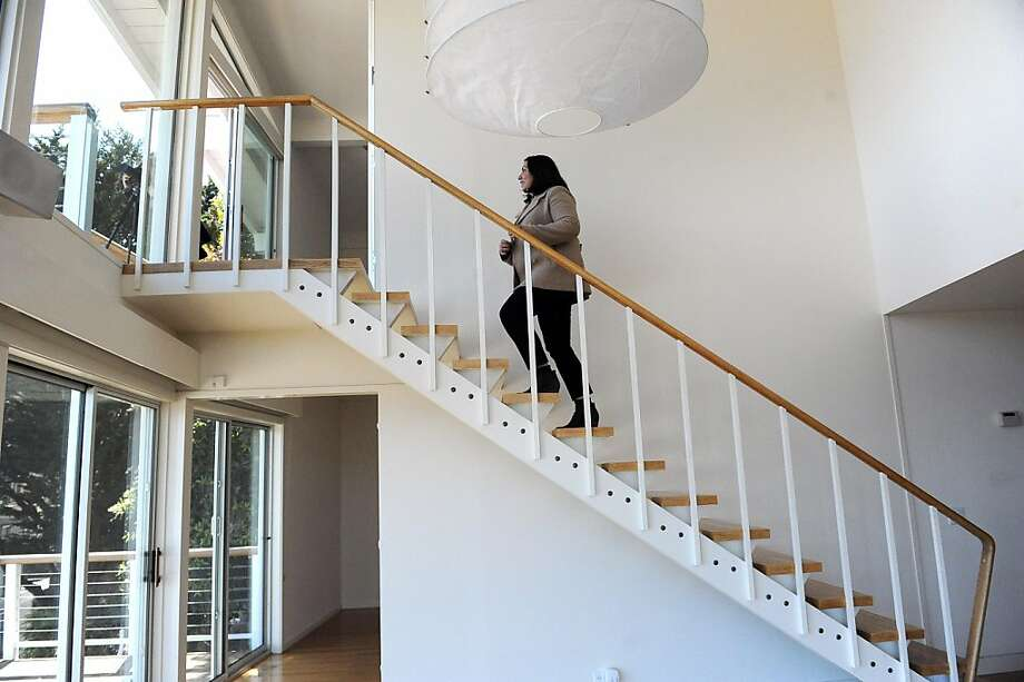 Adelaida Mejia of Vanguard Property checks out a home in San Francisco's Clarendon Heights. She had a client who liked the house, so she wrote a letter to the owners persuading them to sell. Photo: Susana Bates, Special To The Chronicle