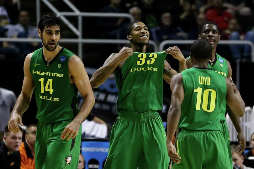 SAN JOSE, CA - MARCH 21:  Carlos Emory #33 of the Oregon Ducks celebrates after dunking in the first