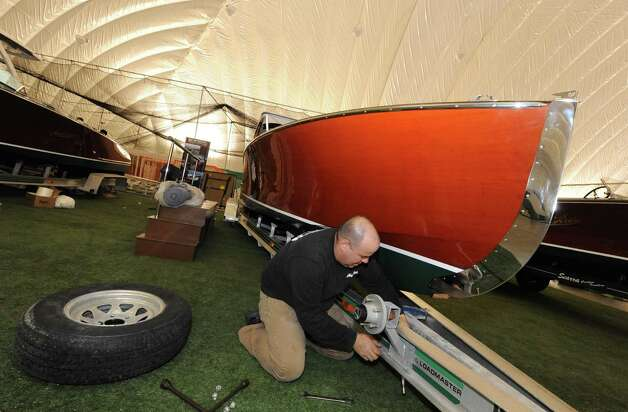 Jay Whitford of Hacker Craft boats gets his display in order during setup for The Great Upstate Boat Show at the  Adirondack Sports Complex on Thursday March 21, 2013 in Queensbury, N.Y. (Michael P. Farrell/Times Union) Photo: Michael P. Farrell