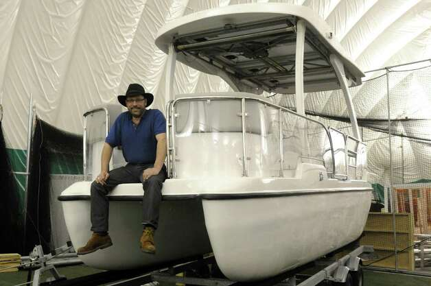 Monte Gisborne with his fully solar powered boat The Loon at The Great Upstate Boat Show at the  Adirondack Sports Complex on Thursday March 21, 2013 in Queensbury, N.Y. (Michael P. Farrell/Times Union) Photo: Michael P. Farrell