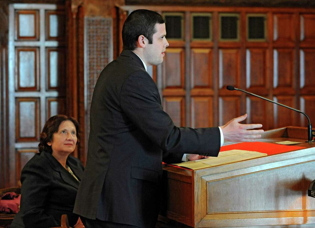 Steve Sharp from the Albany County DA's office Christopher talks to New York Appeals Court judges about the Christopher Oathout trial on Thursday, March 21, 2013 in Albany, N.Y. Christopher Oathout is a former cabdriver found guilty of strangling and stabbing 69-year-old Robert Taylor in 2006. Attorney Cheryl Coleman listens at left. (Lori Van Buren / Times Union)