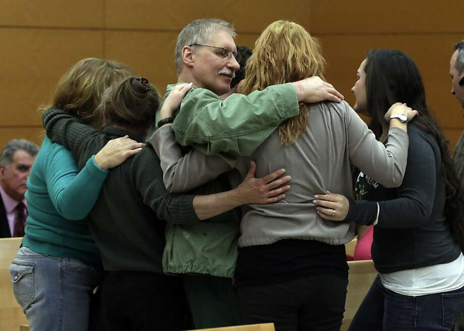 David Ranta, who was convicted of murder in the 1990 cold-blooded slaying of Rabbi Chaskel Werzberger in Brooklyn and has languished behind bars ever since, is hugged by family members after his was freed, in New York state Supreme Court in the Brooklyn borough of New York, Thursday, March 21, 2013. Ranta, 58, who spent more than two decades behind bars, was freed by a New York City judge after a reinvestigation of his case cast serious doubt on evidence used to convict him. (AP Photo/Richard Drew, Pool) Photo: Richard Drew, Associated Press
