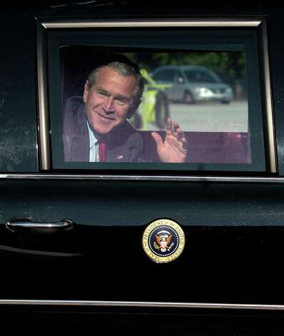 President George W. Bush  waves as he arrives in his limousine before boarding Air Force One at Andrews Air Force Base, in  Maryland, on Sept. 28, 2006. Photo: JIM WATSON, AFP/Getty Images / 2006 AFP