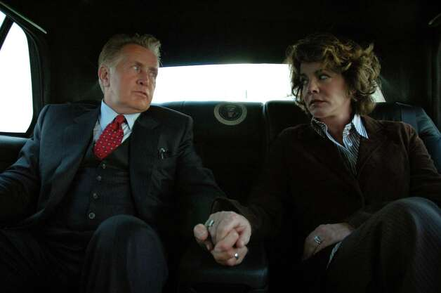 "President Josiah Bartlet rides with first lady Abby Bartlet on Aug. 23, 2004. Wait a minute, that's a shot from ""The West Wing,"" featuring actors Martin Sheen and Stockard Channing. Photo: Patrick Ecclesine, Warner Bros./Getty Images / Warner Bros."