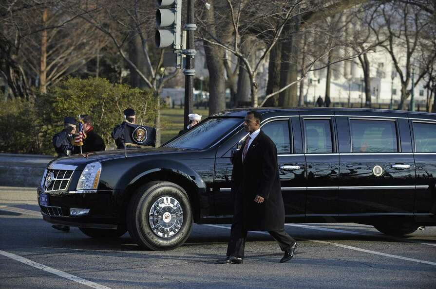 President Barack Obama's limousine begins the presidential inaugural parade in Washington, D.C., on