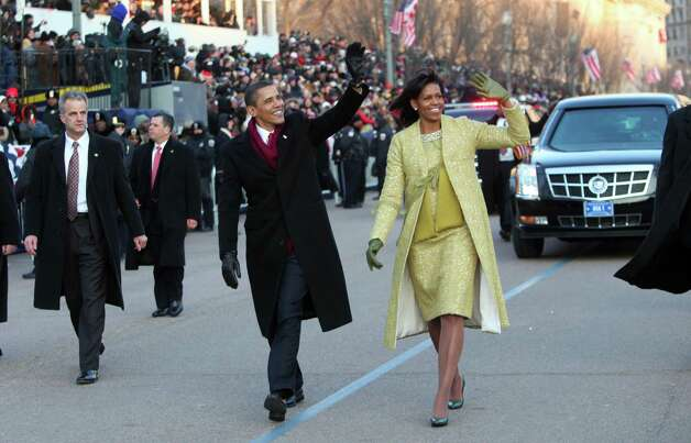 President Barack Obama and first lady Michelle decided to get out and walk during the Inaugural Parade on Jan. 20, 2009 in Washington, D.C. Photo: DOUG MILLS, AFP/Getty Images / 2009 AFP