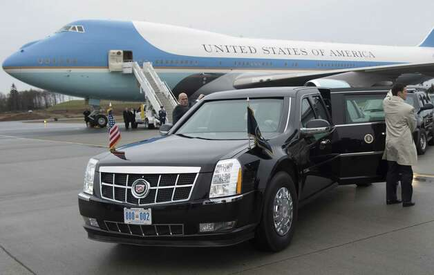 Secret Service agents hold open the doors on President Barack Obama's limousine alongside Air Force One at Paine Field in Everett on Feb. 17, 2012. Photo: SAUL LOEB, AFP/Getty Images / 2012 AFP