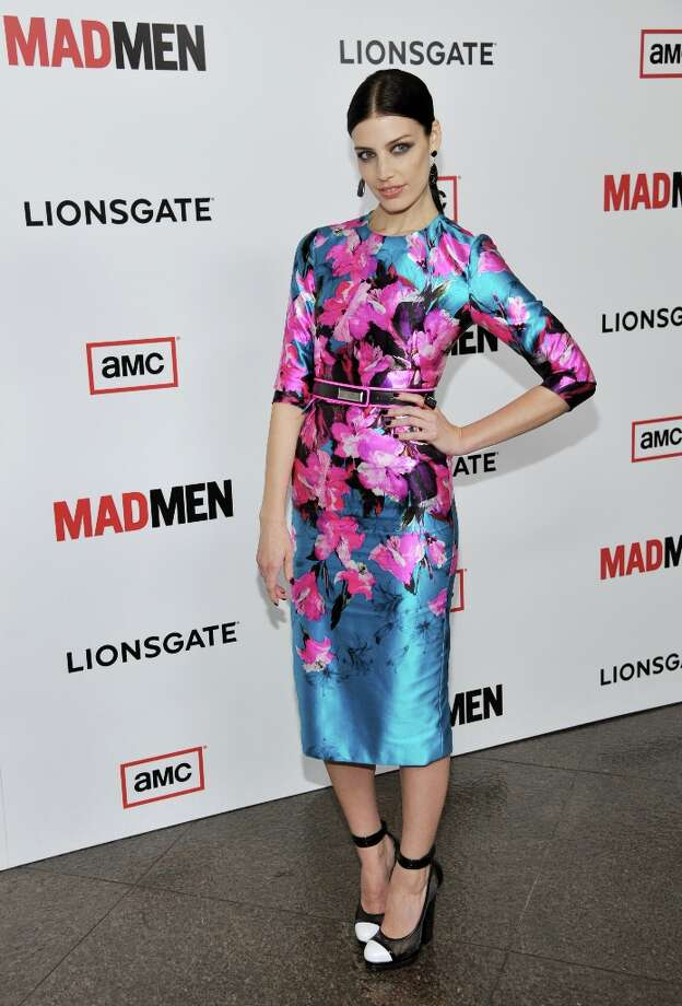 Jessica Pare, a cast member in Mad Men, poses at the season six premiere of the drama series at the Directors Guild of America on Wednesday, March 20, 2013 in Los Angeles. (Photo by Chris Pizzello/Invision/AP) Photo: Chris Pizzello, Associated Press / Invision