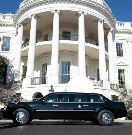 "President Barack Obama's new limousine sits outside of the White House on Jan. 22, 2009. Nicknamed ""The Beast,"" the highly customized Cadillac reportedly weighs eight tons, is based on a truck chassis, and has a fully-sealed passenger compartment, inches of armor, bulletproof windows, run-flat tires and special shocks to absorb blasts. Photo: SAUL LOEB, AFP/Getty Images / 2009 AFP"