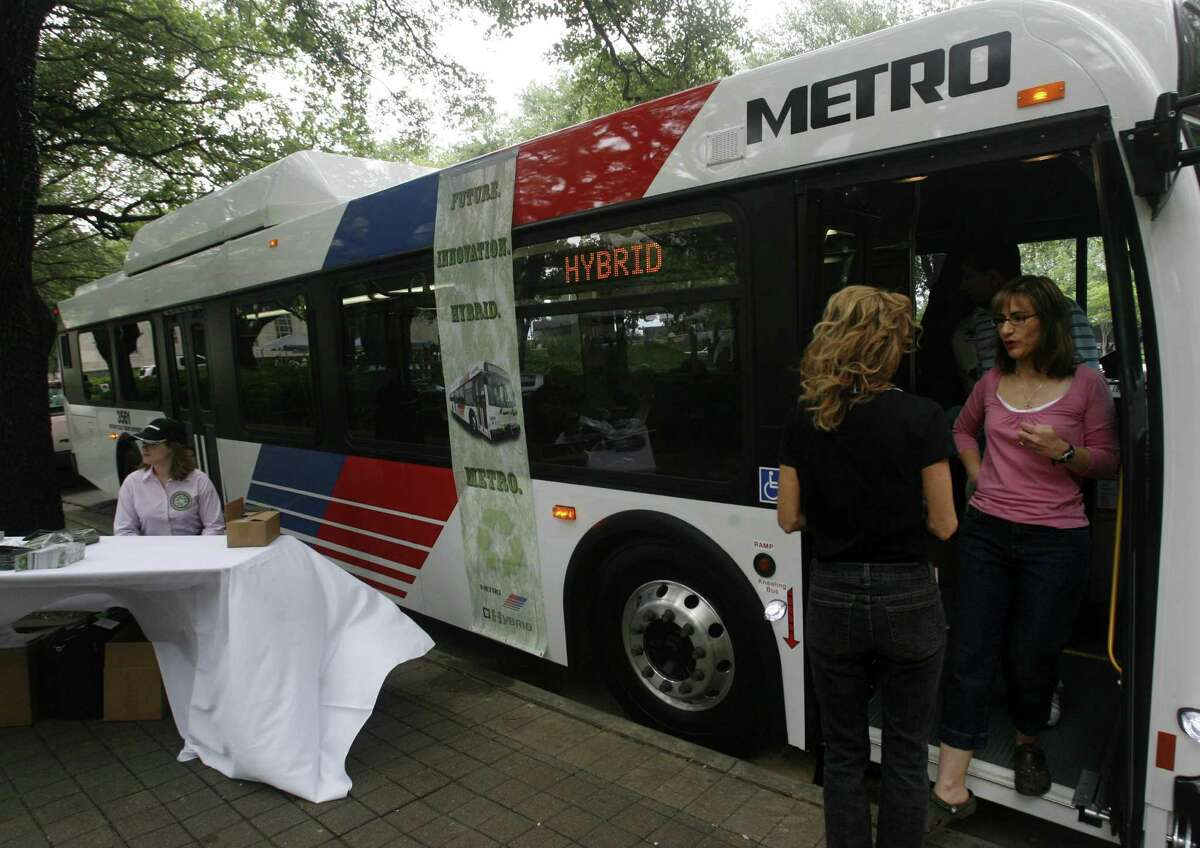 Maria Colon exits a Metro Hybrid Bus that was on display during Fresh Air Friday activities in downtown Houston in 2007.