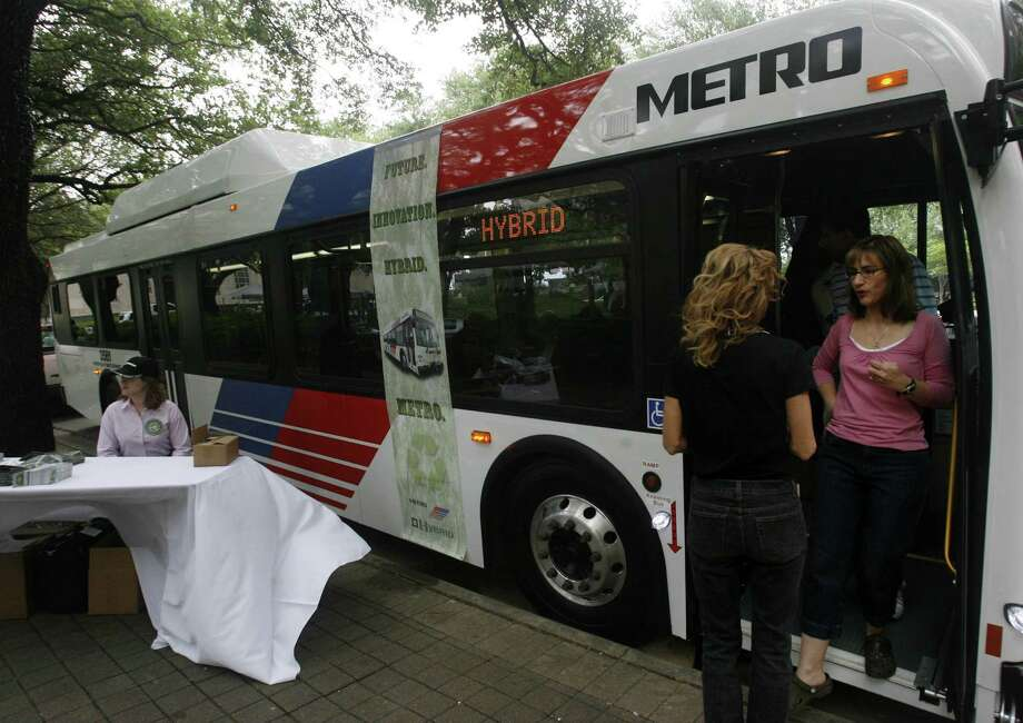 Maria Colon exits a Metro Hybrid Bus that was on display during Fresh Air Friday activities in downtown Houston in 2007. Photo: Mayra Beltran, Staff / Houston Chronicle