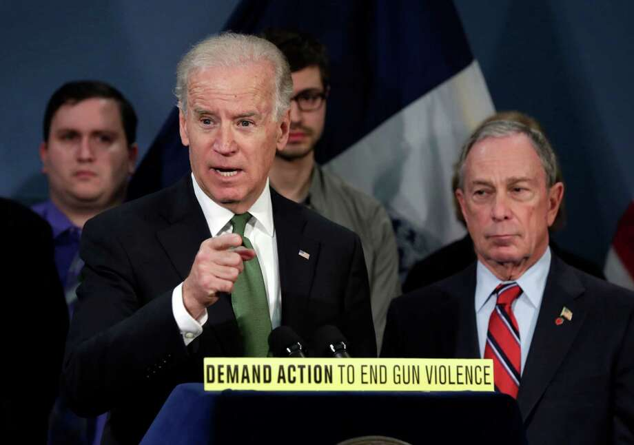 Vice President Joe Biden, left, accompanied by New York Mayor Michael Bloomberg, speaks in New York's City Hall Blue Room, Thursday, March 21, 2013. Relatives of shooting victims from Newtown, Conn., stood with Bloomberg and  Biden as they spoke in favor of an assault weapons ban. (AP Photo/Richard Drew) Photo: Richard Drew, Associated Press / AP