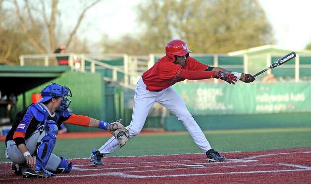 Lamar shortstop Sam Bumpers, #9, reaches on strike three in the second during the Lamar University baseball game against Houston Baptist University on Wednesday, March 20, 2013, at Vincent-Beck Stadium. Photo taken: Randy Edwards/The Enterprise Photo: Randy Edwards