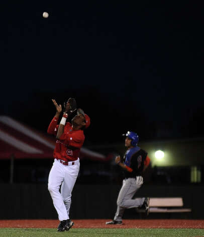 Lamar shortstop Sam Bumpers, #9, gets under a pop fly to end the top of the sixth inning the Lamar University baseball game against Houston Baptist University on Wednesday, March 20, 2013, at Vincent-Beck Stadium. Photo taken: Randy Edwards/The Enterprise Photo: Randy Edwards