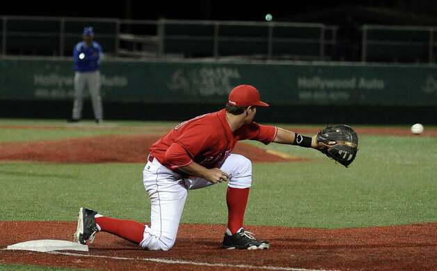 Lamar first baseman Brad Picha, #23, makes the stretch to gain the last out of the top of the seventh inning during the Lamar University baseball game against Houston Baptist University on Wednesday, March 20, 2013, at Vincent-Beck Stadium. Photo taken: Randy Edwards/The Enterprise Photo: Randy Edwards