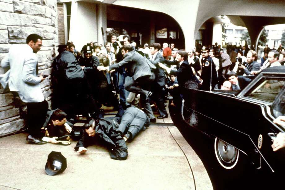 John Hinckley Jr. attempted to assassinate President Ronald Reagan on March 30, 1981, while Reagan was leaving a speaking engagement at the Washington Hilton Hotel in Washington, D.C. Reagan was hit in the chest and was hospitalized for 12 days. Press Secretary James Brady (just behind the car) was paralyzed. Hinckley was found not guilty by reason of insanity. Photo: MIKE EVENS, AFP/Getty Images / 2010 AFP