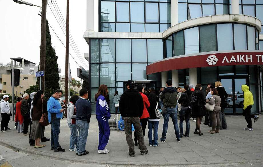 The European Central Bank has threatened to cut off emergency aid to  Cyprus' banks by Monday if a rescue plan isn't in place. Photo: Pavlos Vrionides, STR / AP
