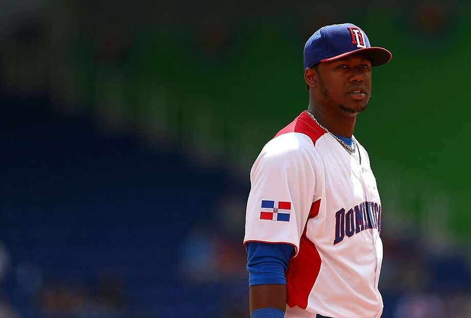 Hanley Ramirez tore a thumb ligament diving for a ball at AT&T Park in the WBC final. Photo: Mike Ehrmann, Getty Images