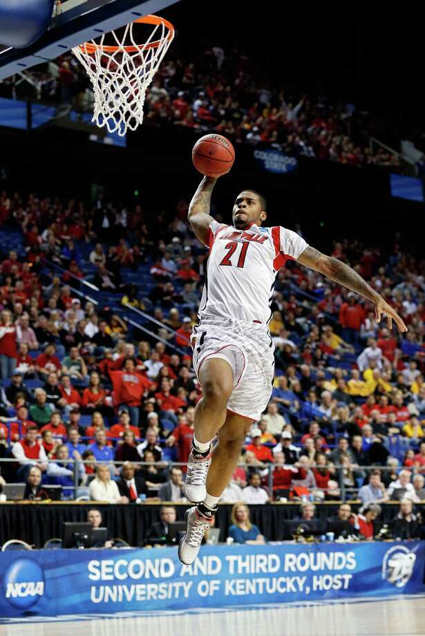 Louisville 79, North Carolina A&T 47LEXINGTON, KY - MARCH 21:  Chane Behanan #21 of the Louisville Cardinals goes up for a dunk that he would miss against the North Carolina A&T Aggies during the second round of the 2013 NCAA Men's Basketball Tournament at the Rupp Arena on March 21, 2013 in Lexington, Kentucky. Photo: Kevin C. Cox, Getty Images / 2013 Getty Images