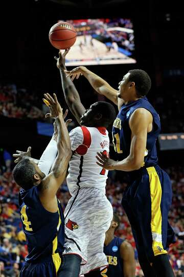 LEXINGTON, KY - MARCH 21:  Stephan Van Treese #44 of the Louisville Cardinals shoots the ball agains