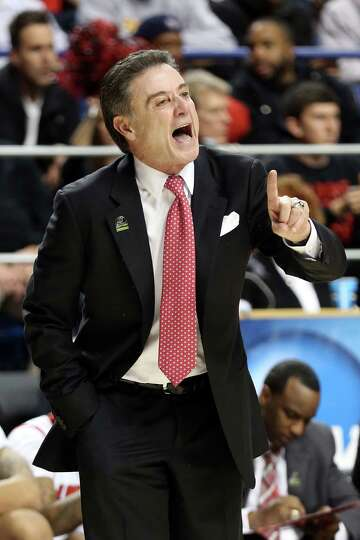 LEXINGTON, KY - MARCH 21:  Head coach Rick Pitino of the Louisville Cardinals shouts from the sideli