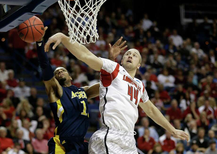 North Carolina A&T forward Adrian Powell (1) has his shot blocked by Louisville forward Stephan Van Treese (44) during the first half of a second-round game in the NCAA college basketball tournament, Thursday, March 21, 2013, in Lexington, Ky. (AP Photo/John Bazemore) Photo: John Bazemore, Associated Press / AP