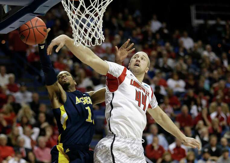 North Carolina A&T forward Adrian Powell (1) has his shot blocked by Louisville forward Stephan Van