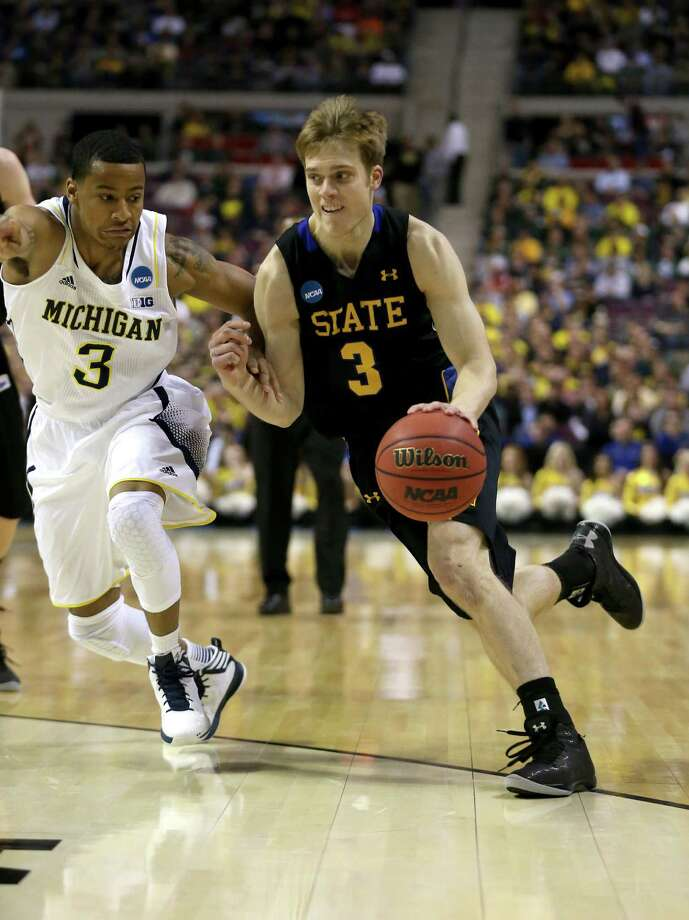 AUBURN HILLS, MI - MARCH 21:  Nate Wolters #3 of the South Dakota State Jackrabbits drives in the first half against Trey Burke #3 of the Michigan Wolverines during the second round of the 2013 NCAA Men's Basketball Tournament at at The Palace of Auburn Hills on March 21, 2013 in Auburn Hills, Michigan. Photo: Jonathan Daniel, Getty Images / 2013 Getty Images