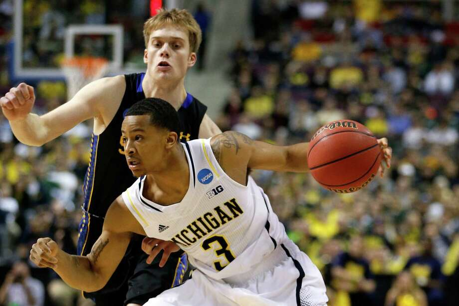 AUBURN HILLS, MI - MARCH 21:  Trey Burke #3 of the Michigan Wolverines drives in the first half against South Dakota State Jackrabbits during the second round of the 2013 NCAA Men's Basketball Tournament at at The Palace of Auburn Hills on March 21, 2013 in Auburn Hills, Michigan. Photo: Gregory Shamus, Getty Images / 2013 Getty Images