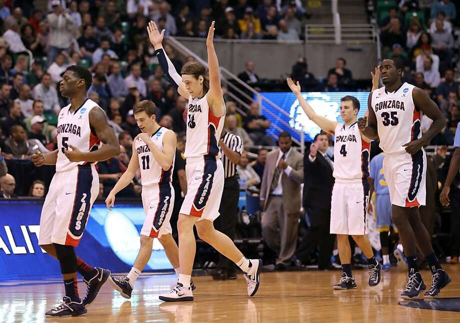 With Gonzaga on its way to weathering the storm, it's all good for Gary Bell Jr. (left), David Stockton, Kelly Olynyk, Kevin Pangos and Sam Dower as they head to the bench late in the win over Southern. Photo: Streeter Lecka, Getty Images