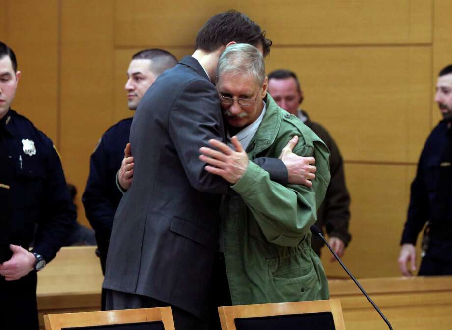 David Ranta is hugged by attorney Pierre Sussman. Ranta, who spent years in prison, was freed after doubts surfaced about evidence in a rabbi's murder. Photo: Richard Drew, POOL / POOL AP