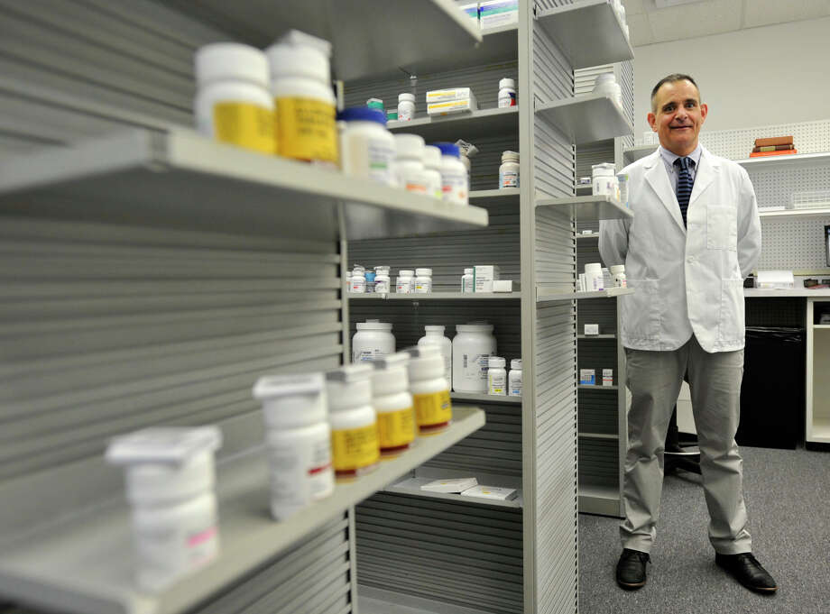 John Ciuffo is the pharmacist and owner of Cornerstone Pharmacy on Stillwater Avenue in Stamford. Photographed on Wednesday, March 20, 2013. Photo: Jason Rearick / The (Stamford) Advocate