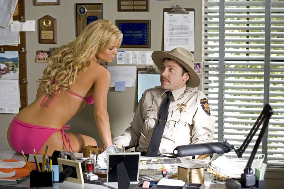 Jessica Simpson made good use of a pink bikini as Daisy Duke in the ''Dukes of Hazard,'' with Michael Weston as Deputy Enos Strate.