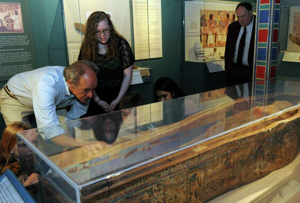 Egyptologist, Bob Brier, left, talks about inscriptions on the mummy sarcophagus at the Albany Institute of History & Art on Thursday March 21, 2013 in Albany, N.Y. (Michael P. Farrell/Times Union)