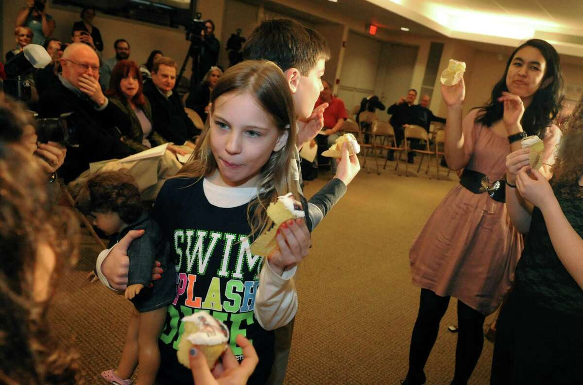 Nine-year-old Beth Gannon of Albany samples one of the cupcakes that revealed the finding of the mummy X-ray findings at the Albany Institute of History & Art on Thursday March 21, 2013 in Albany, N.Y. (Michael P. Farrell/Times Union)