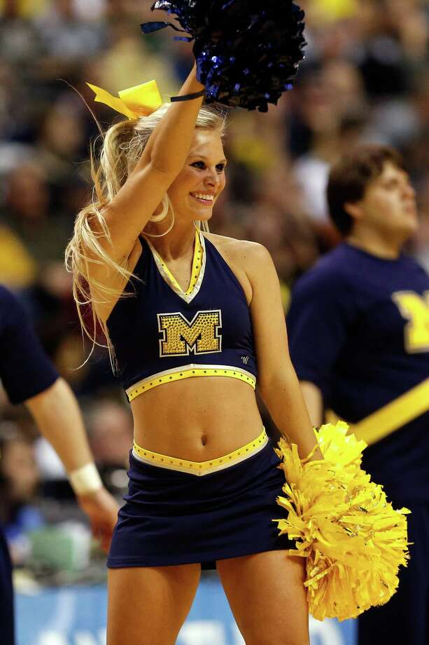A cheerleader for the Michigan Wolverines performs against the South Dakota State Jackrabbits. Photo: Gregory Shamus, Getty Images / 2013 Getty Images