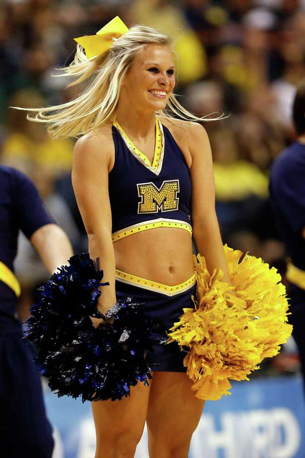 A cheerleader for the Michigan Wolverines performs against the South Dakota State Jackrabbits during the second round. Photo: Gregory Shamus, Getty Images / 2013 Getty Images